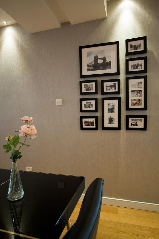 复古简约风餐厅 黑色系相片墙欣赏