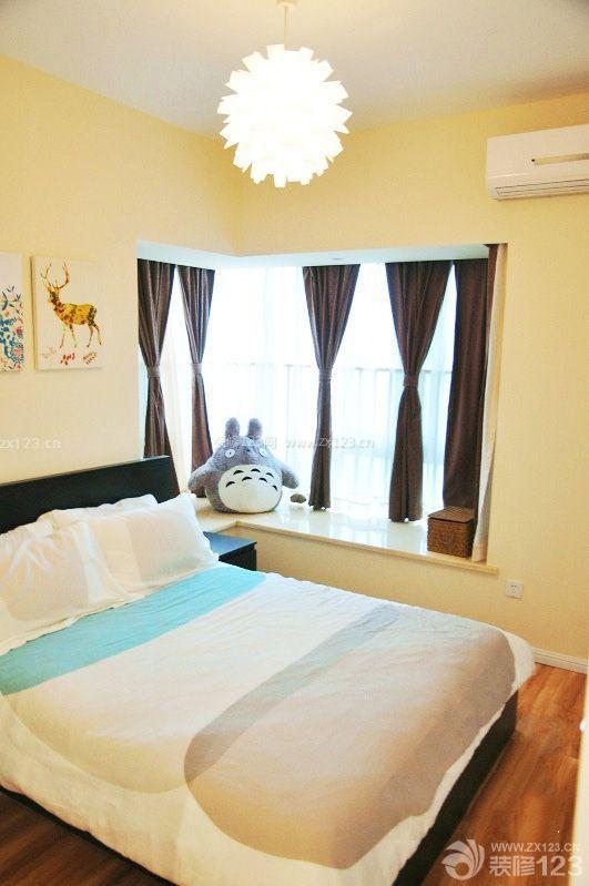 简约时尚卧室黄色墙面装修效果图大全